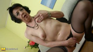 mature lady plays with her vibrator