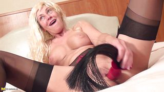 mature blonde has her butt plug
