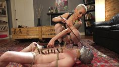 tattoed dominatrix works on slave's hot body