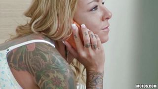 inked milf shows her assets and her skills