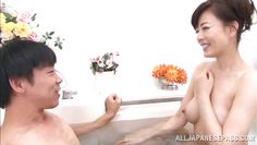 mature japanese lady gets in the tub with him