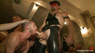 gay hunks dressed in leather have an orgy
