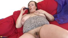 chubby mature plays with her dildo
