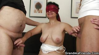 blindfolded granny tastes two cocks