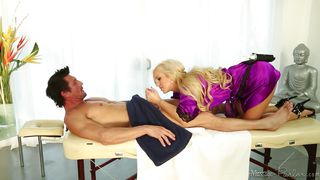 blonde masseuse with long hair gives a flawless head