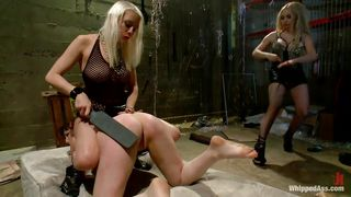 two blondes spank and punish a slut