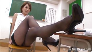 japanese teacher gives her student a footjob