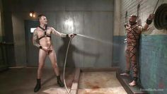 spraying down his dirty slave boy