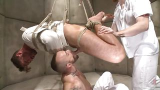 man in straitjacket gets awfully used