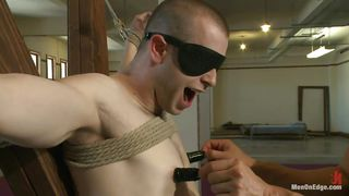 blindfolded boy enjoys his punishment