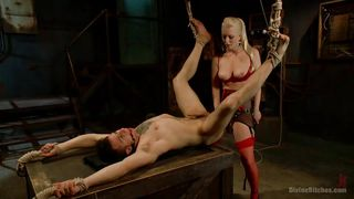 blonde dominatrix using a big strap on