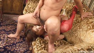 japanese milf in red sucks on the balls
