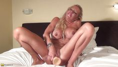 smoking hot mature uses her huge dildo