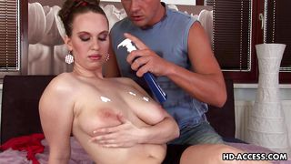 mature lady gets lotion on her tits