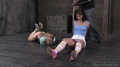 two girls tied up in a sex dungeon