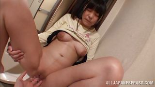 japanese babe with shaved pussy gets fingered in the bathroom