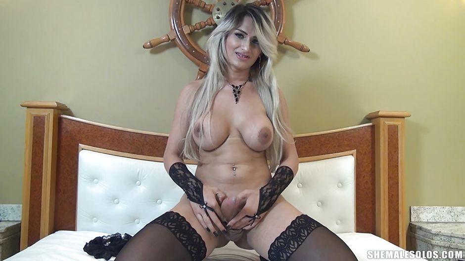 Blonde ladyboy masturbates