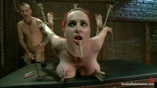 redheaded milf gets clothespins on her tits and rammed from behind