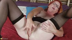 mature redhead spreads her legs wide