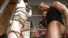 gagged stud gets used by horny torturers