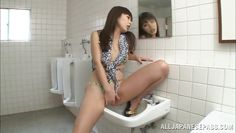 horny asian bitch masturbates in the bathroom