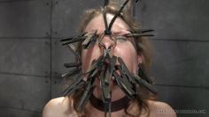 clothespins all over her face