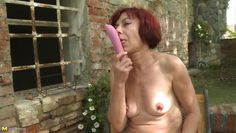 mature redhead has fun with a sex toy