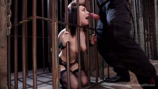 slutty brunette trapped in a cage