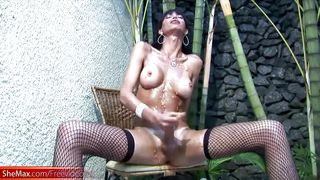 arousing tranny rubs papaya all over her dick and cumshots