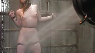 redheaded milf gets sprayed with shower hose