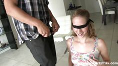 knelt and blindfolded to suck a big cock