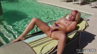 blonde babe masturbates while tanning