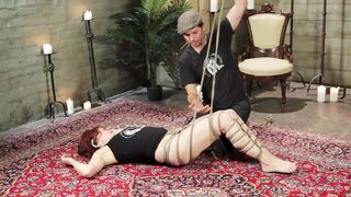 shibari is demonstrated by the expert