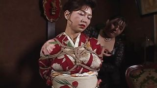 tied geisha awaits her punishment