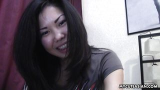 asian bitch plays with pussy