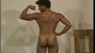 sexy stud works out and lifts weights naked
