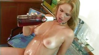 blonde pours alcohol on her body