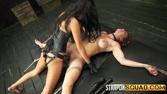 lesbian with strap on has fun