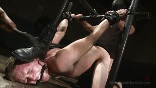 zane is chained, shackled and caned