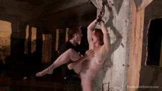 redhead is shackled and fucked