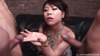 japanese beauty sucks on two cocks like a slut