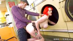busty redhead gets fucked in public laundry