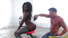black chick gets her ass oiled up