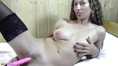 curly haired mature playing dildo.