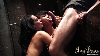 two dark haired women suck cock