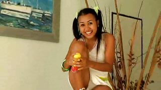 sexy thai chick plays with silly string