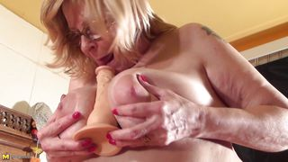 chubby mature practices with a dildo
