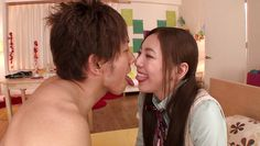 japanese cutie jacks him off while kissing