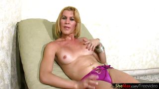 blond shemale strips off panties and takes cock in her hands