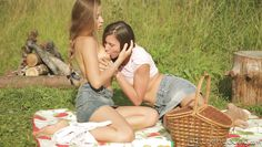 cute brunettes frolic in the meadow
